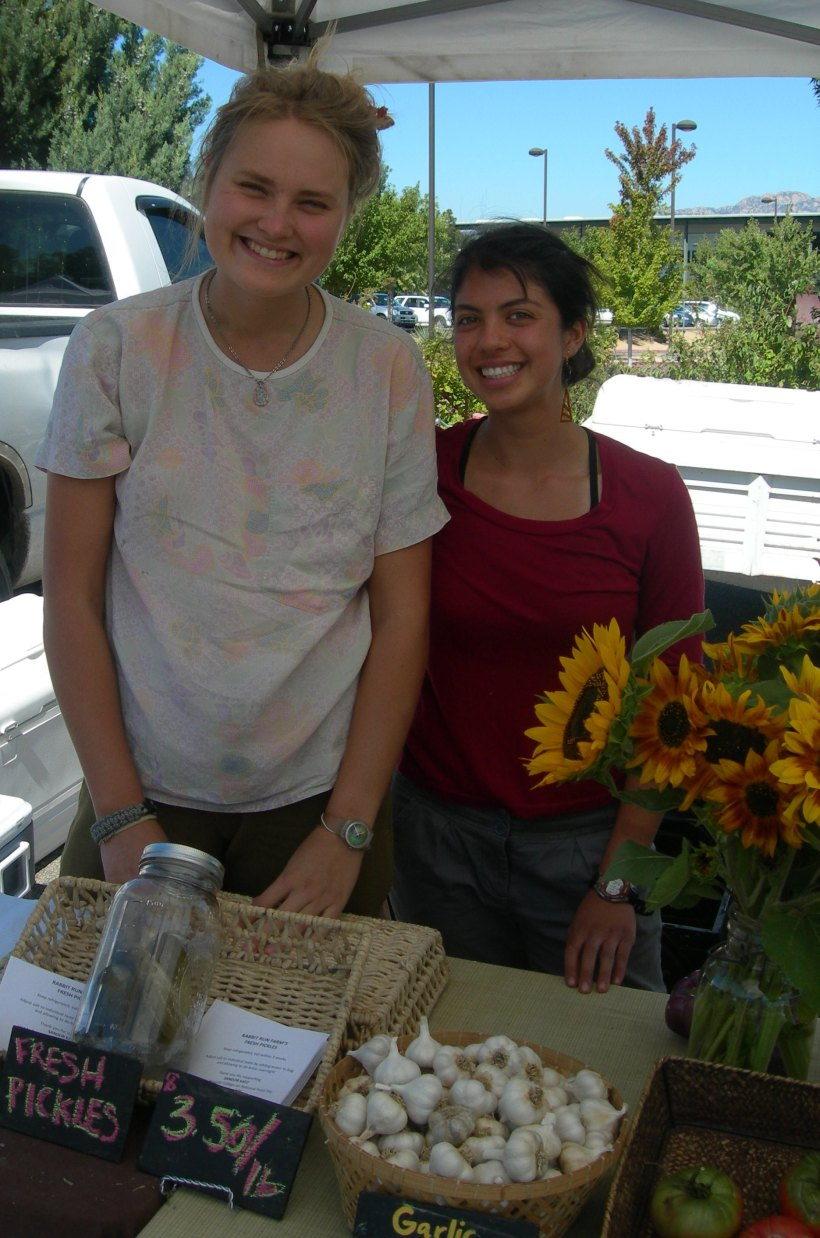 Eleanore and Nicole selling pickles at Rabbit Run Farm's booth at market